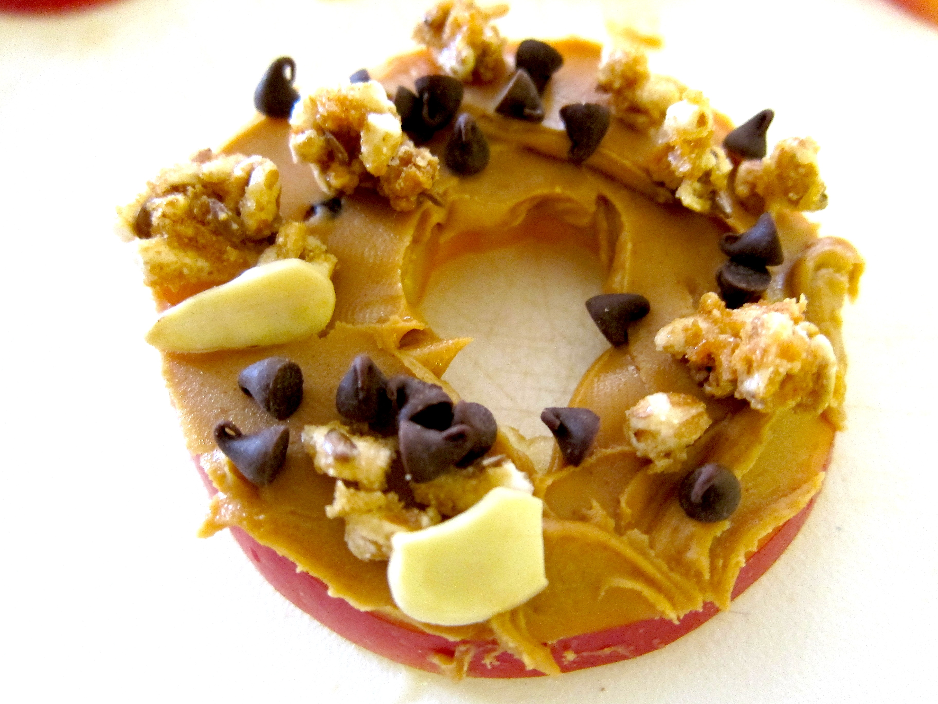 Top your sliced apple with granola, chocolate chips, peanut butter ...